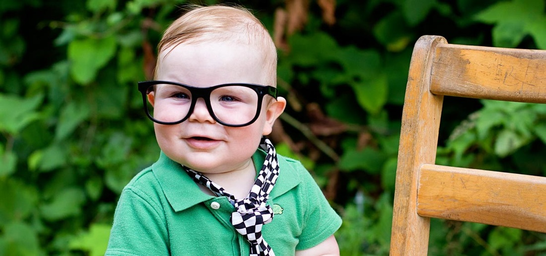 Boy with Black Glasses and Green Shirt