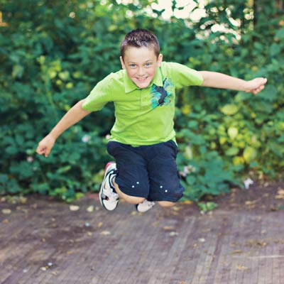 Boy jumping and smiling